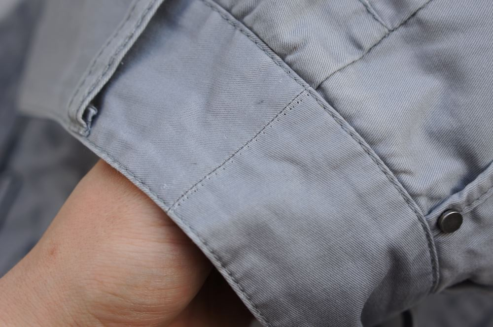 Stitch marks in grey trousers