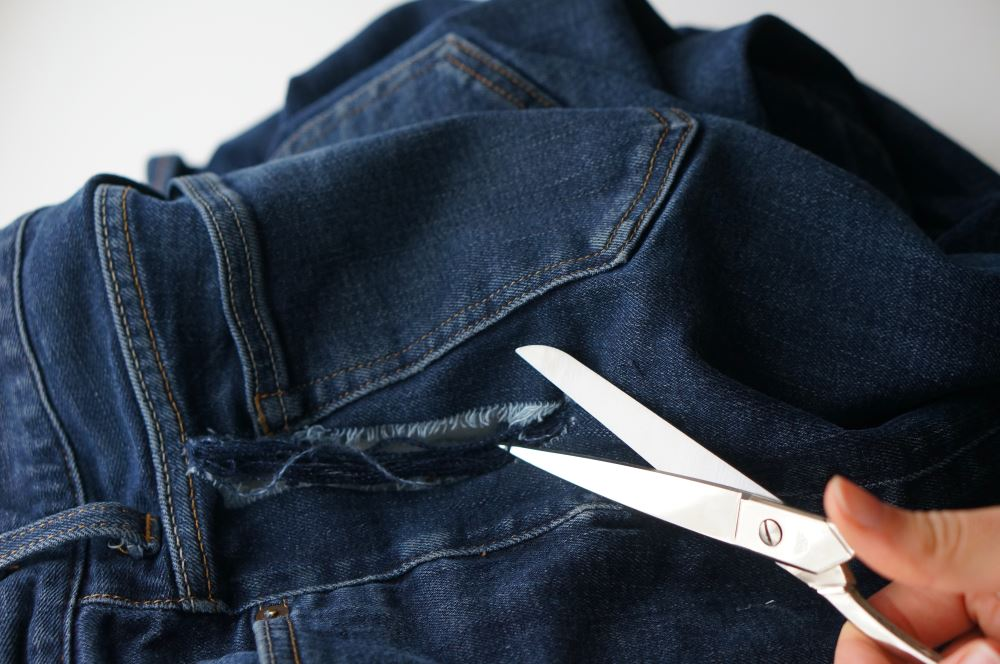 jeans fabric ripped out with scissors showing