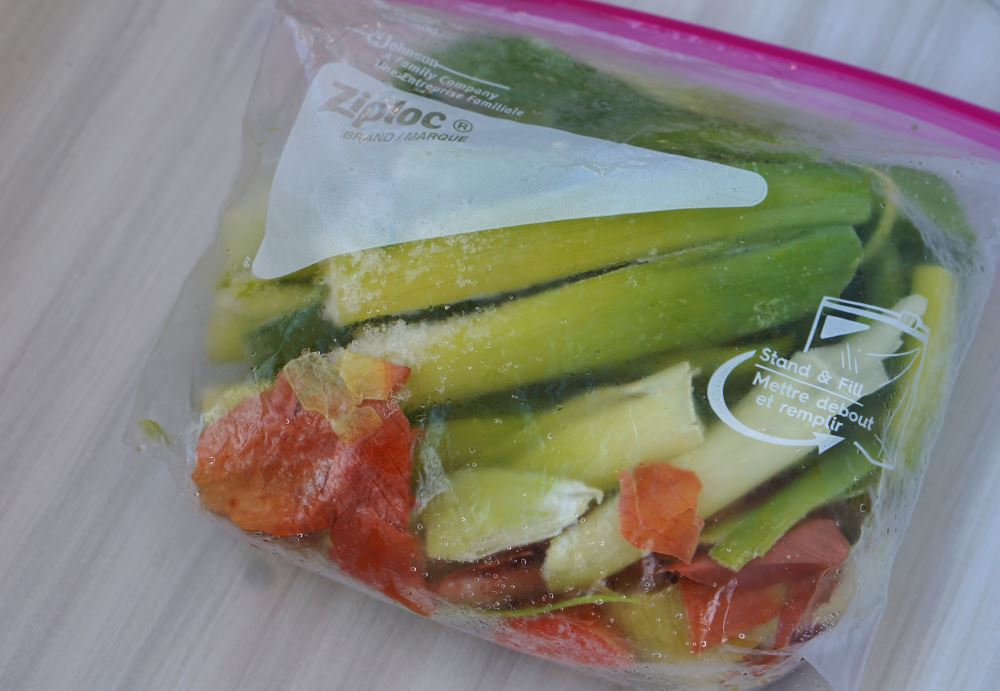 ziploc bag with vegetable scraps