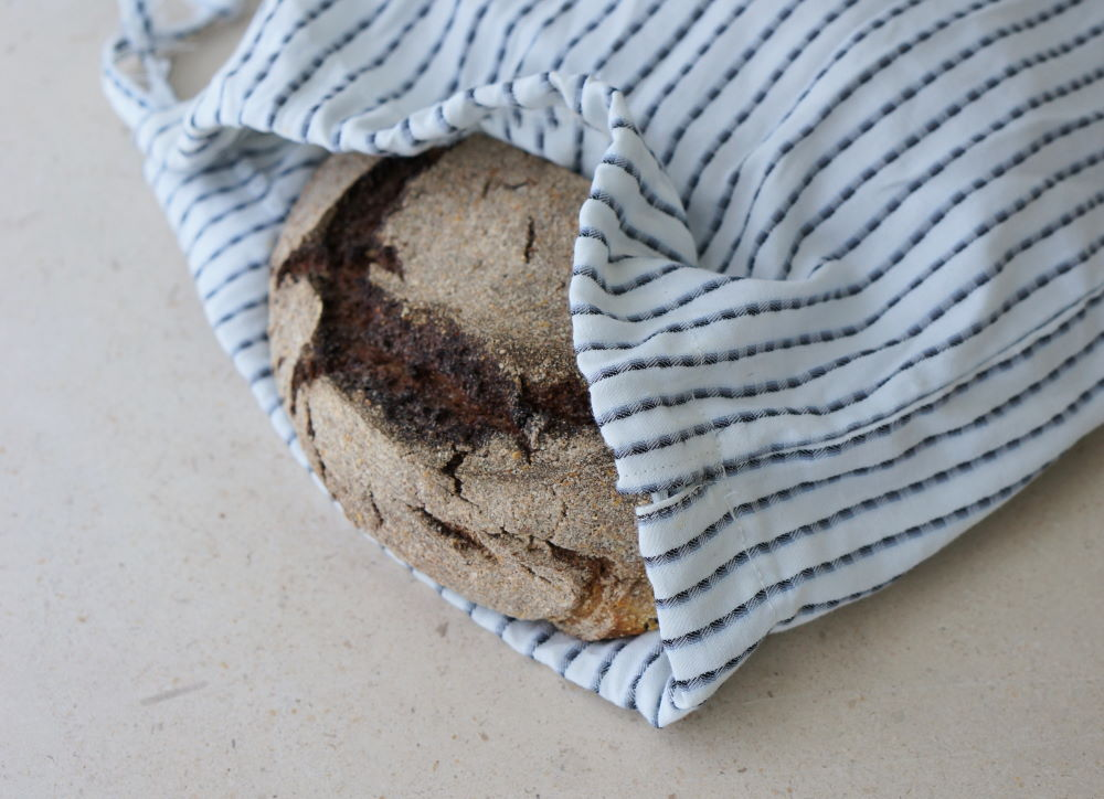 reusable bread bag with bread inside peaking