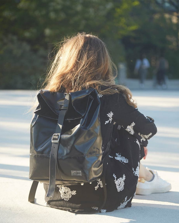 woman on the back with backpack