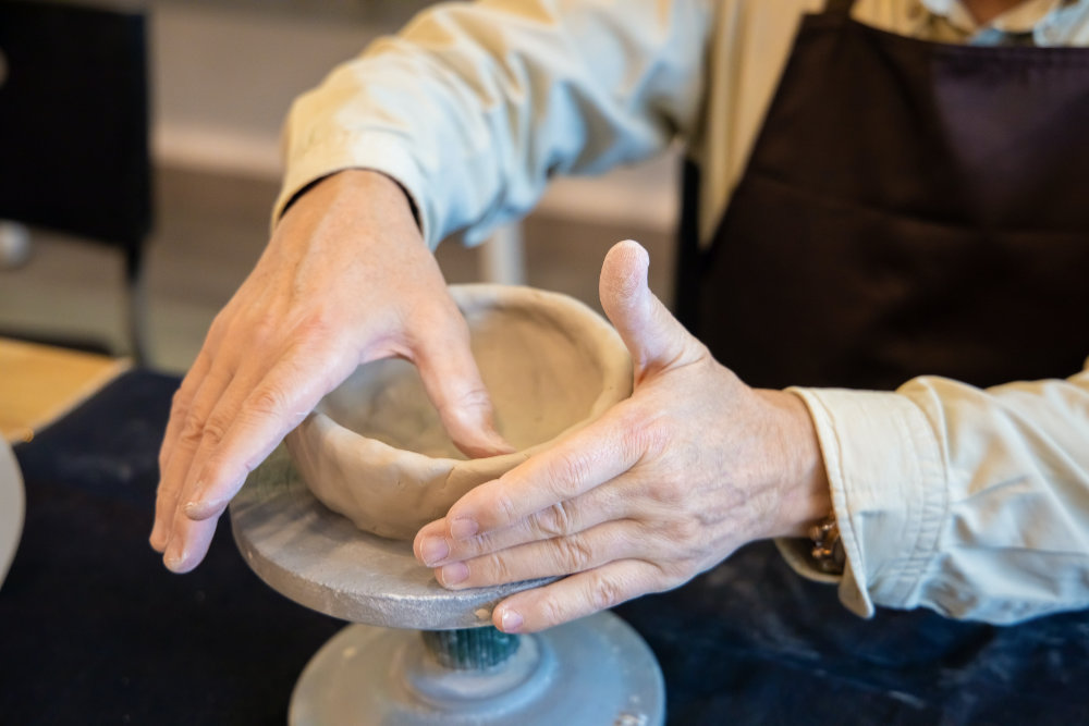 person doing pottery