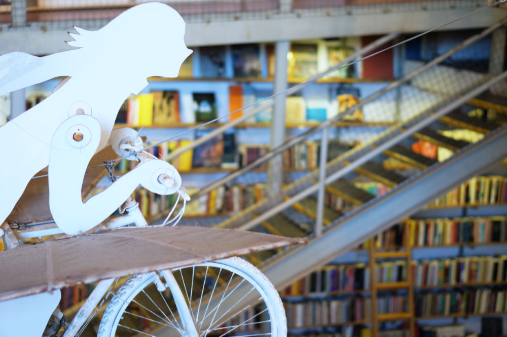 white sculpture with books on the back