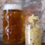 jar of sauerkraut with beer on the back