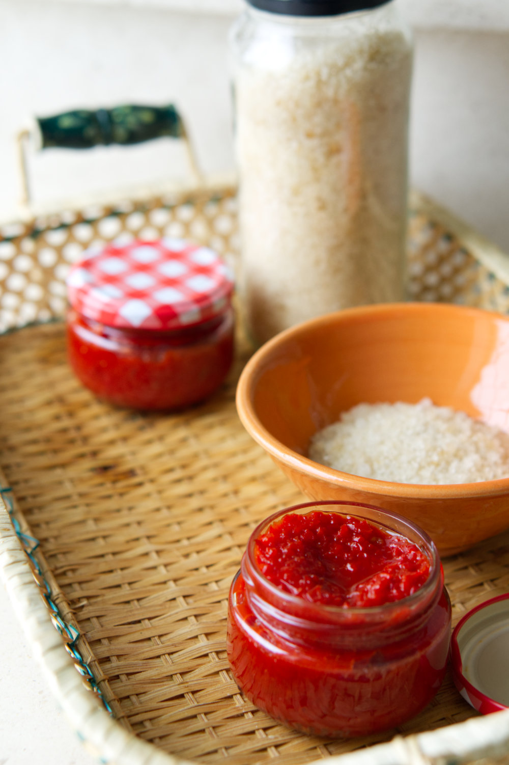 red pepper paste in jar with red pepper infused salt