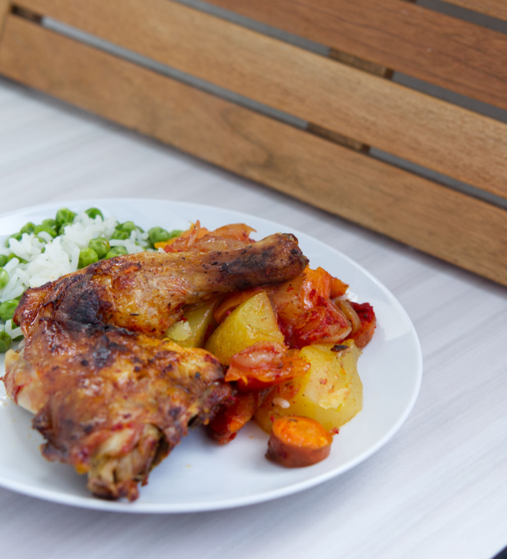 plate with chicken with red pepper paste and potatoes